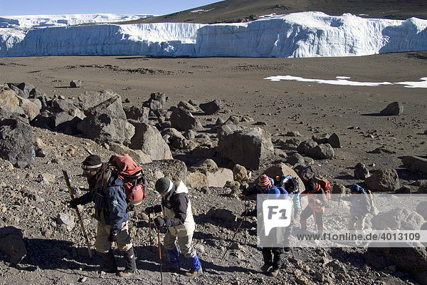 Mountaineer and local guide at the ascent to the summit of the Kilimanjaro via the Western Breach route  Tanzania  Africa