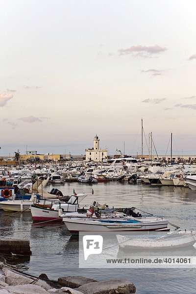 Boats in the port of Manfredonia with the lighthouse at back  Gargano  Foggia  Apulia  Puglia  South of Italy  Europe