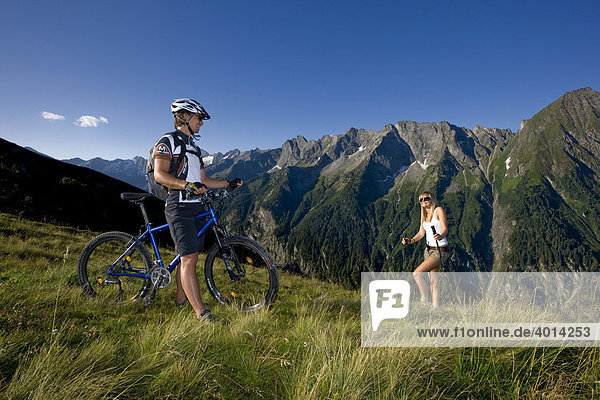 Mountain biker and a hiker  Zillertal Alps  Mayerhofen  North Tyrol  Austria  Europe