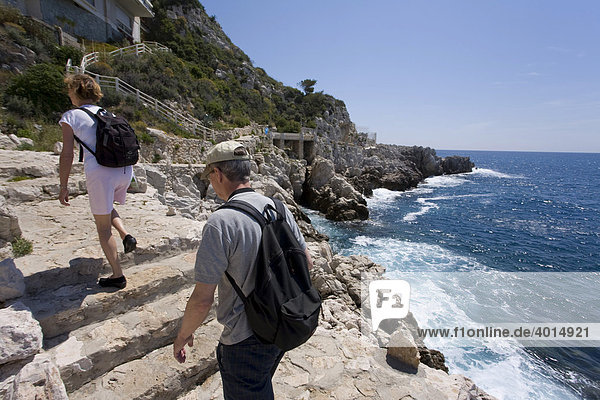 Pedestrians on the Sentier du Bord de Mer coastal path  Nice  Cote d'Azur  France