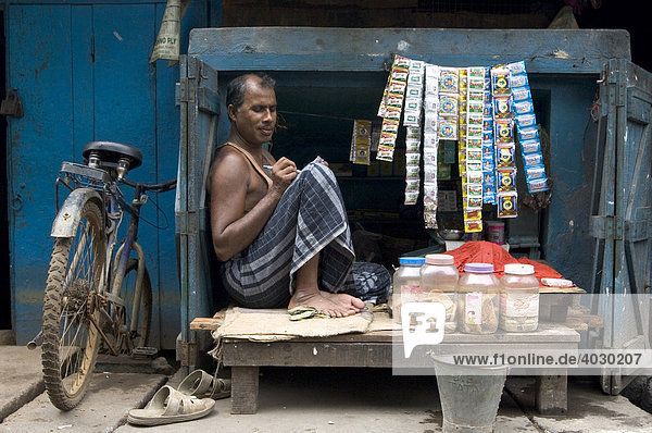 Shop owner in the slums of Howrah  Hooghly  West Bengal  India
