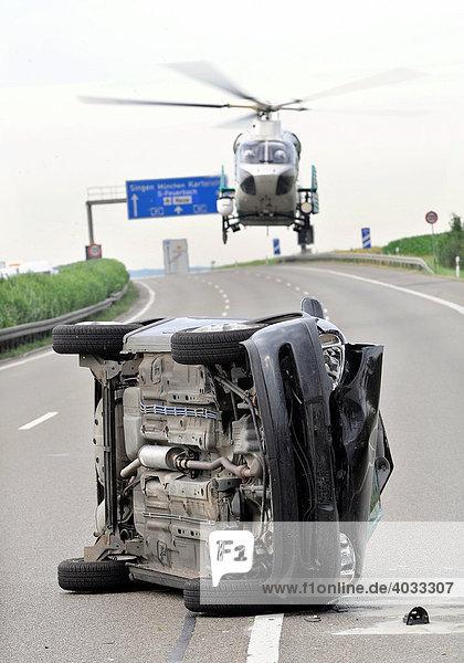 Accident on a motorway  car on its side  police helicopter landing  A 81 to Stuttgart between Zuffenhausen und Ludwigsburg-Sued  Stuttgart-Korntal  Baden-Wuerttemberg  Germany  Europe