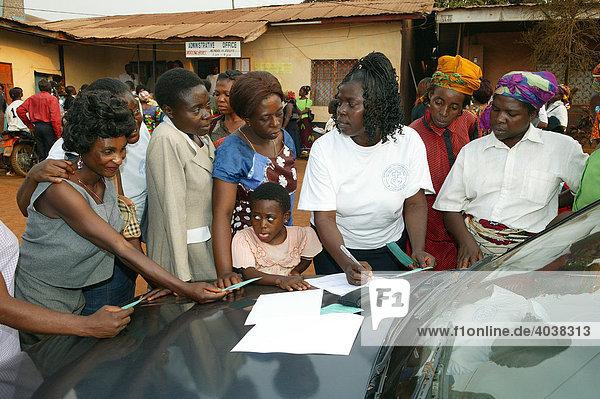 Women distributing school materials  Women's Education Centre  Bamenda  Cameroon  Africa