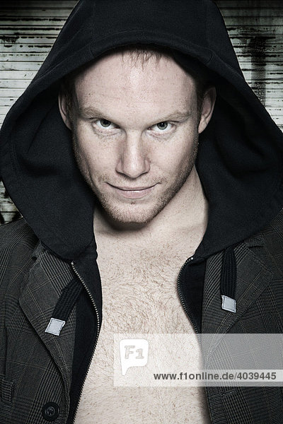 Portrait of a young man wearing a hooded sweatshirt