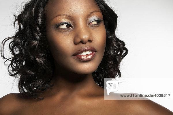 Portrait of a young dark-skinned woman looking sideways