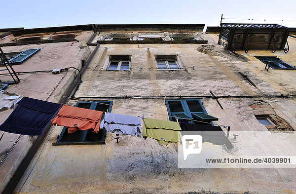 House facade with washing lines in Dolcedo  Riviera dei Fiori  Liguria  Italy  Europe
