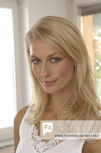 Portrait of a beautiful woman with long blond hair