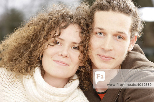 Woman with curly hair and a man with dreadlocks