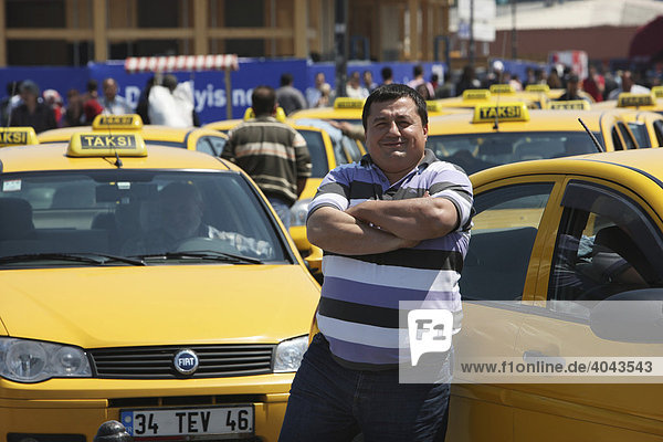 Taxis and a taxi driver on the Eminoenue bank of the Bosporus  Istanbul  Turkey
