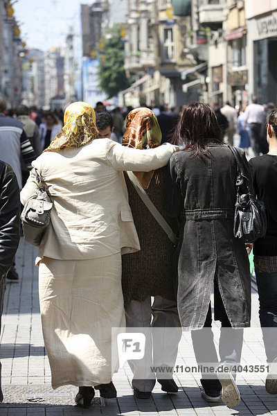 Turkish women strolling on the main shopping street Istiklal Caddesi in the Beyoglu district  Istanbul  Turkey