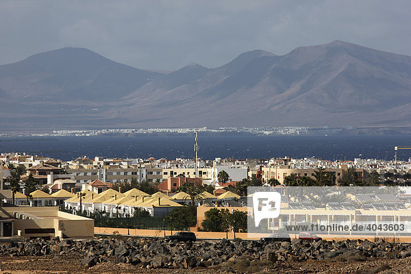 Northern tip of the island of Fuerteventura  view to the neighbouring island Lanzarote across the town of Corralejo  Fuerteventura  Canary Islands  Spain  Europe