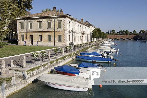 Harbour with boats in Peschiera del Garda  Lake Garda  Lago di Garda  Lombardy  Italy  Europe