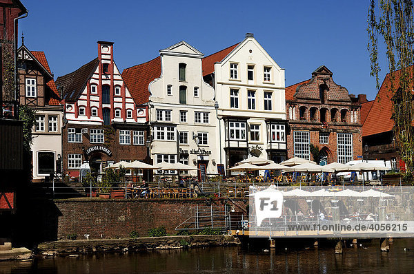 Old gable houses and open air pubs on the river  Lueneburg  Lower Saxony  Germany  Europe