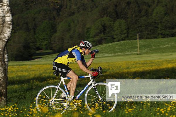 Racing cyclist  Grabenstaett  Chiemgau  Bavaria  Germany  Europe