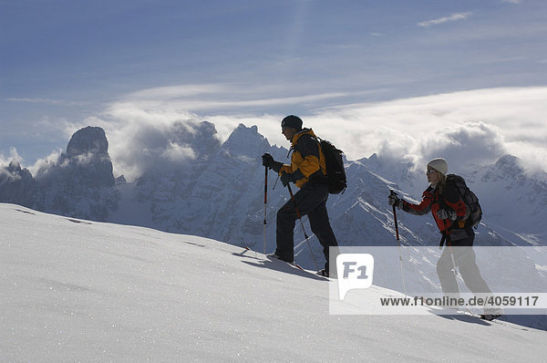 Snowshoe hikers on the Plaetzwiese Meadow in front of the Monte Cristallo Massif  High Puster Valley or Alto Pusteria  Bolzano-Bozen  Dolomite Alps  Italy  Europe