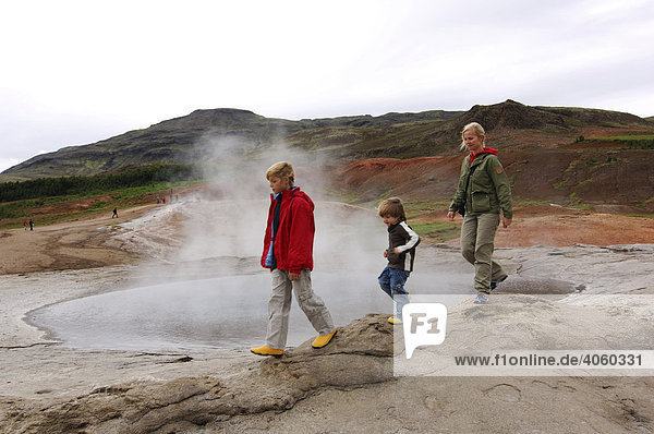 Woman and two children  hot spring  geyser  Iceland  Europe