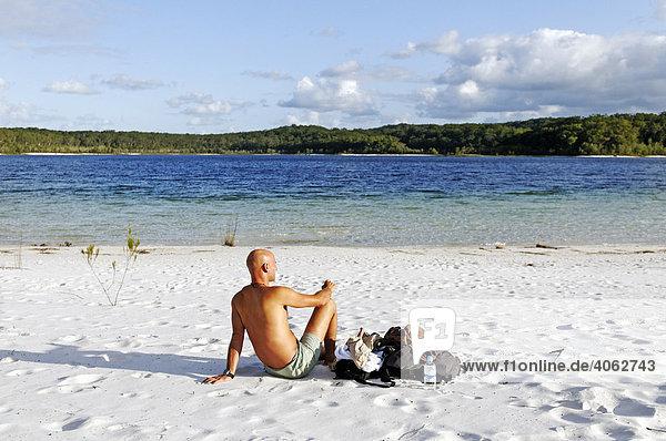 Man on the beach at Lake McKenzie  Fraser Island  Queensland  Australia
