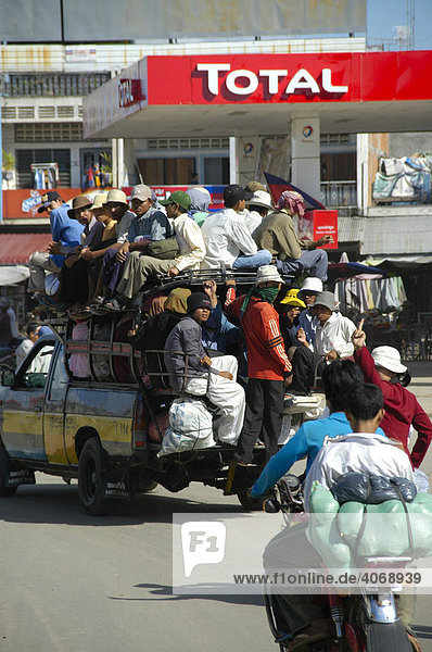 Crammed full pick up truck in front of a gas station at ferry station Neak Loeang  Cambodia  Southeast Asia