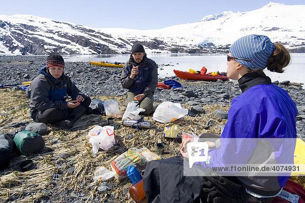 Sea kayak  resting  picnic  Blackstone Bay  Pacific Coast  Prince William Sound  Alaska  USA