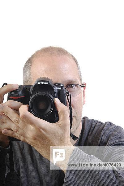 Fotograf mit digitaler Spiegelreflexkamera