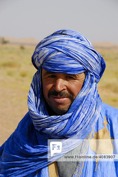 Portrait Tuareg dressed in blue robe and turban Erg Chebbi Merzouga Morocco