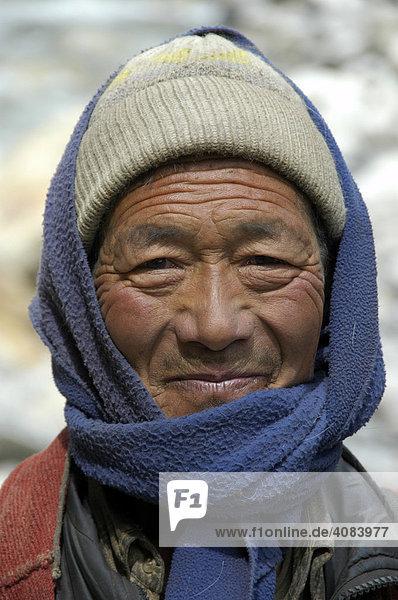 Portrait friendly man wearing coat cap and shawl Nar-Phu Annapurna Region Nepal