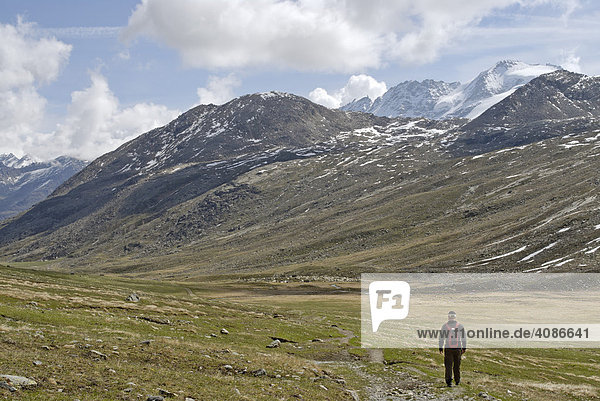 Gran Paradiso National Park between Piemonte Piedmont and Aosta valley Italy Garian Alps hikers at the old path to the Val Salvarenche at the high plateau Plan di Nivolet