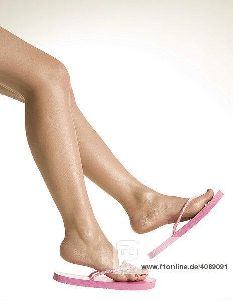Beine baumeln  Flip-Flops