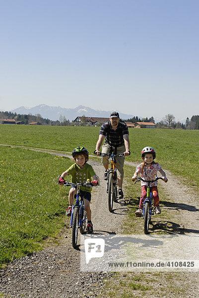 Family on a bicycle ride near Koenigsdorf  Upper Bavaria  Germany  Europe