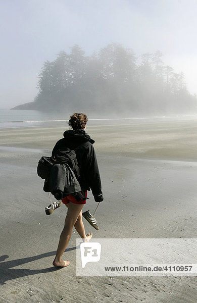 Walking on the sandy beach of the Pacific coast inside Pacific Rim National Park near Tofino on Vancouver Island  British Columbia  Canada