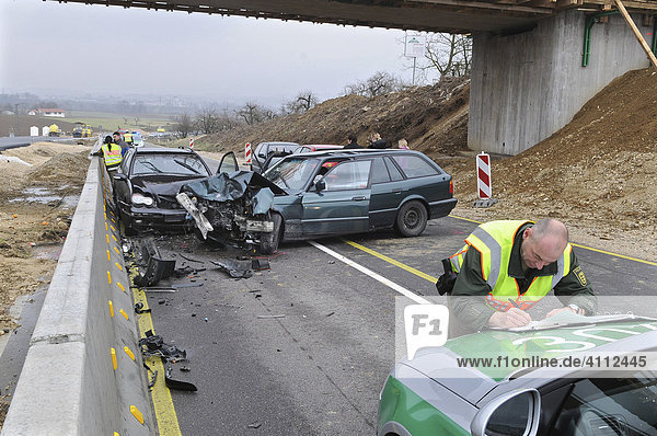 Police officer during the acquisition of accident data of a car accident  Nuertingen  Esslingen Region  Baden-Wuerttemberg  Germany  Europe