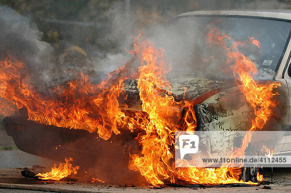 Burning car  training for the FFW Owen auxiliary or volunteer fire brigade at the Leuze Electronic Company  Braike Industrial Zone  Owen  Esslingen Region  Baden-Wuerttemberg  Germany  Europe