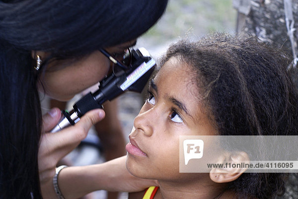 Female Doctor examining a children¥s eyes in Imbiribeira slum (favela)  Recife  Brazil