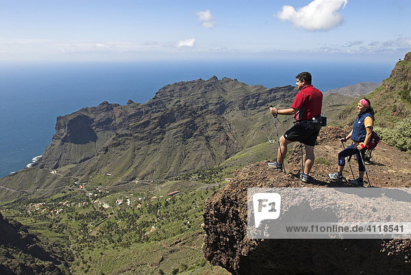 Hiker/Nordic Walker at a viewpoint overlooking the canyon of Taguluche  La Gomera Island  Canary Islands  Spain  Europe