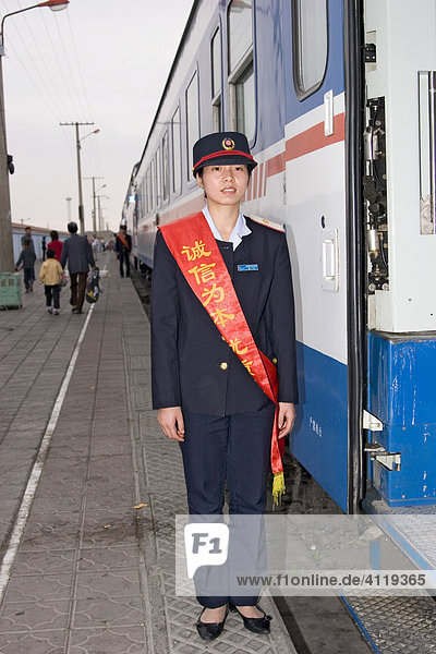 Asia  china  chinese officer in front of train on platform in liuyuan.