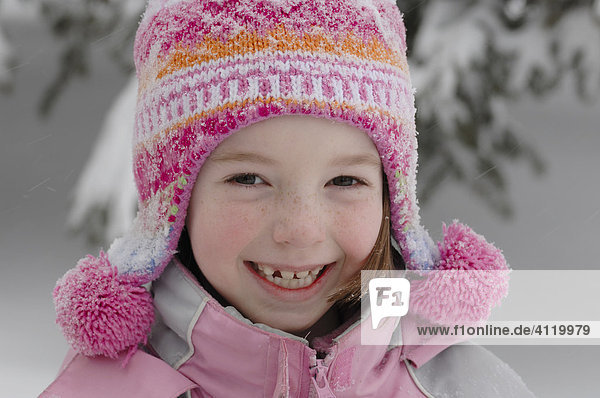 Young smiling girl dressed up for winter