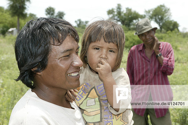 Father with child on his arms  Nivaclé Indians  Jothoisha  Chaco  Paraguay  South America