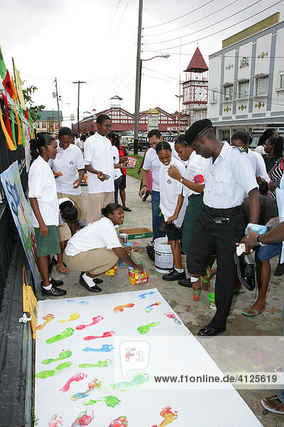 Colourful footprints to symbolize diverse ethnic backgrounds  protesting violence against women  in Georgetown  Guyana  South America