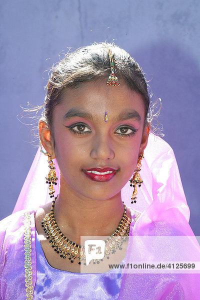 Portrait of a girl of Indian ethnicity at a Hindu Festival in Georgetown  Guyana  South America