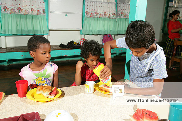 Girls with full plates  everyday life at an Ursuline convent and orphanage  Georgetown  Guyana  South America