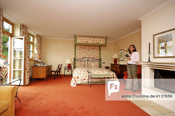 Brauereigasthof Aying  hotel  room  standing woman  Aying  Upper Bavaria  Bavaria  Germany