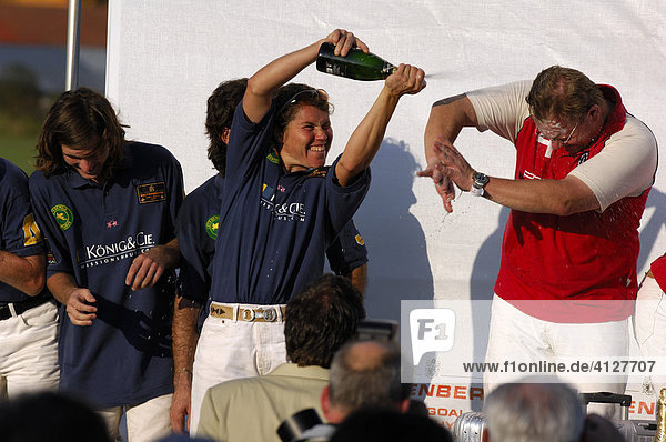 Dirk Baumgaertner is getting a Champagner shower from Eva Bruehl at the winner honoring  Polo tournament  Berenberg High Goal Trophy 2007  Thann  Holzkirchen  Upper Bavaria  Bavaria  Germany