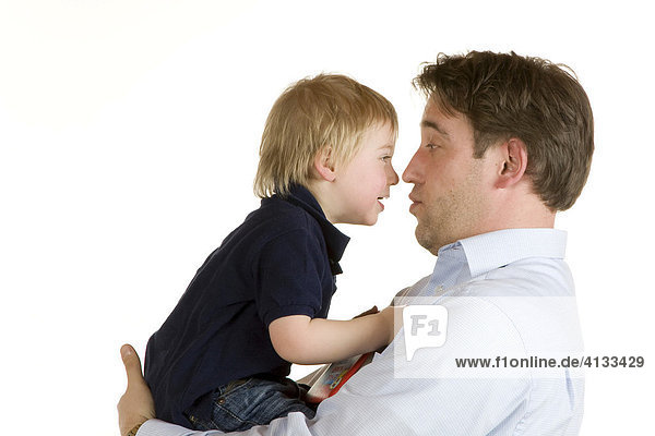 Father holding his two-year old son  playing