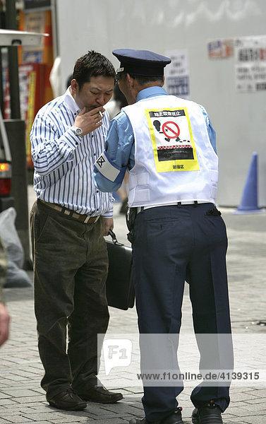 Japan  Tokyo: Anti-smoking officer on the streets of Shinjuku.