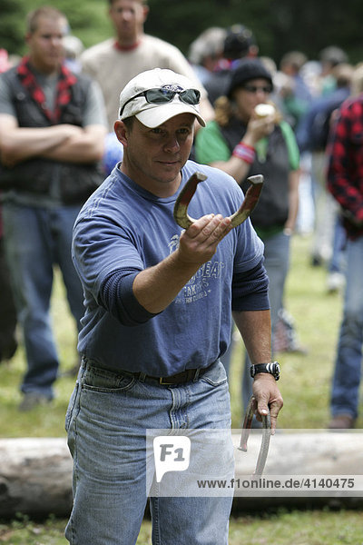 Horseshoe throwing contest during Fourth of July celebrations (Independence Day) in Gustavus: population 400  Alaska  USA  North America