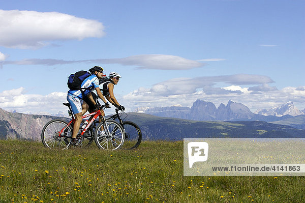 Female and male mountain bikers at Auener Joch  Northern Italy  Europe