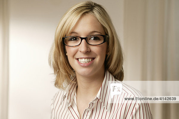 Smiling young blonde woman with glasses