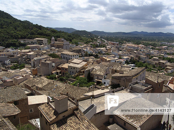 ESP  Spain  Balearic Islands  Mallorca : View from the castle over the Church Santuari de Sant Soalvador onto the roofs of the oldtown of Arta.