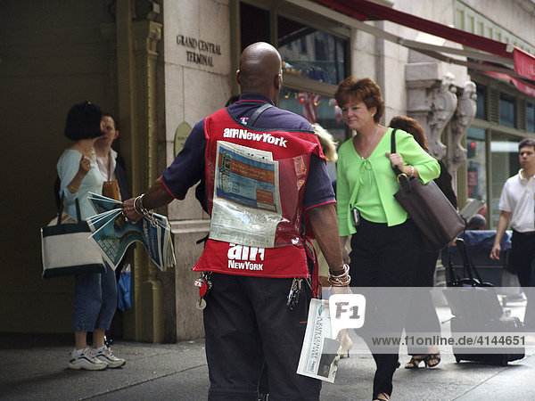 USA  United States of America  New York City: Newspaperman on the street. free of charge morning newspaper AM new york.