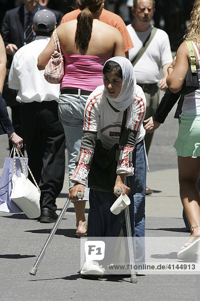 USA  United States of America  New York City: Midtown Manhattan  5th Avenue. Beggar.